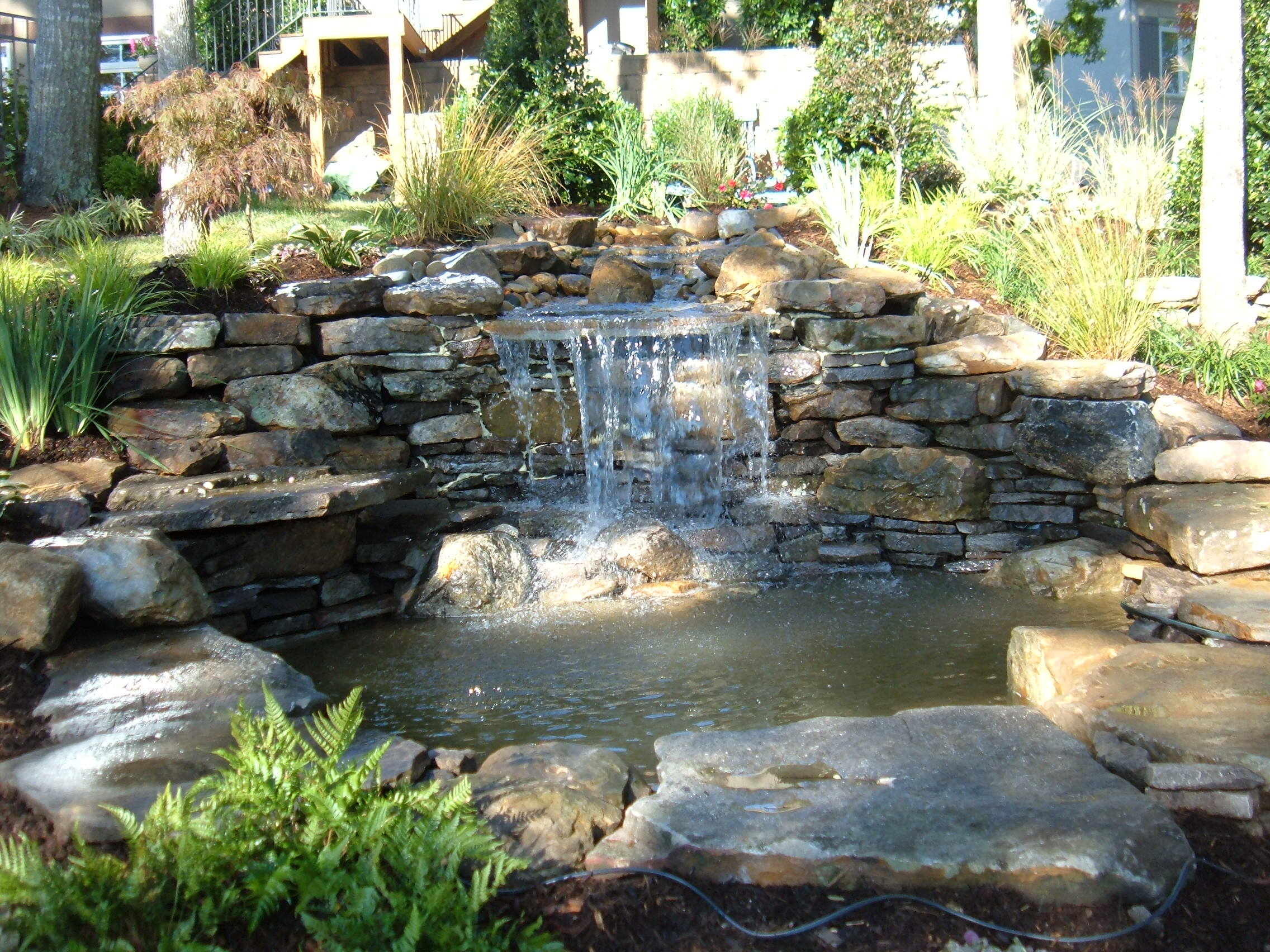 Backyard waterfall for Yard waterfalls